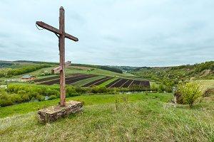 Religious cross on spring field