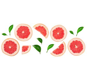 Grapefruit slices with leaves isolated on white background with copy space for your text. Top view. Flat lay pattern