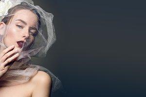 A girl in a white veil.