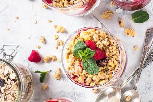 Yogurt parfafait with granola and raspberries top view.