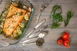 Grilled salmon fish with fresh herbs