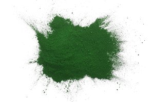 Spirulina algae powder isolated on white background. Top view