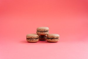 Macarons isolated on pink background