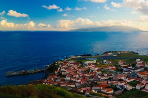 Aerial view to Vila do Corvo and Flores island at sunset, Corvo island, Azores, Portugal