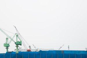 Crane lifts at harbor