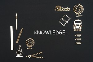 School supplies placed on black background with text knowledge
