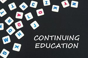 english colored square letters scattered on black background with text continuing education