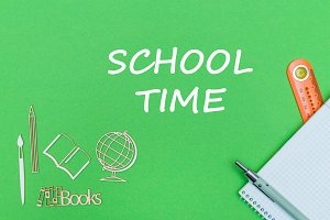 text school time, school supplies wooden miniatures, notebook on green background