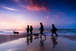 Family walk on the beach