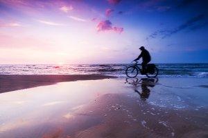 Riding a bike on the beach