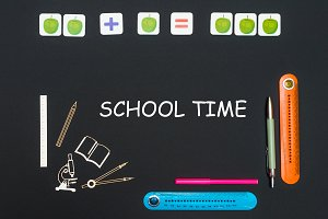 Above stationery supplies and text school time on blackboard