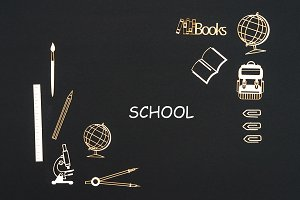 School supplies placed on black background with text school