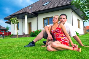 Couple in front of their ideal house