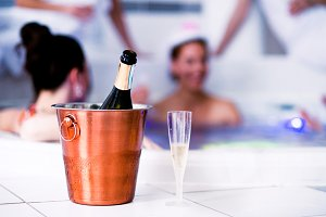 Glass and bottle of champagne in bucket, hen party