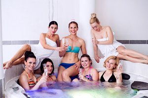 Bride and bridesmaids celebrating hen party in wellness center