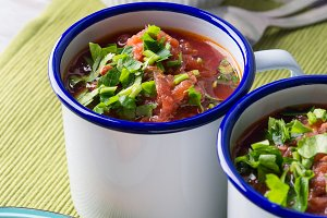 Russian beetroot soup borscht in enamel mugs