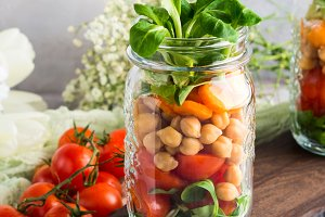 Fresh salad lunch served in mason jars