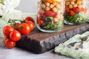 Fresh salad lunch served in mason jars