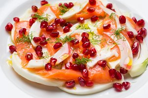 Salad with fennel, salmon and pomegranate