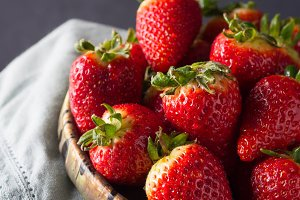 Fresh strawberries on a green cloth