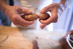 Unrecognizable man making sausages the traditional way at home.