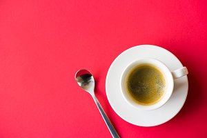Cup of Coffee on Red Background