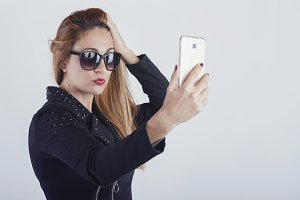 Beautiful woman taking a selfie