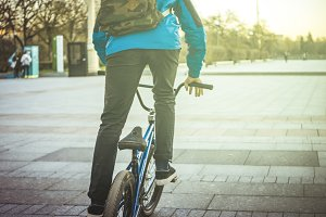 young man with his bmx bicycle in the urban street on a sunny day