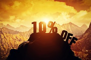 10% off writing on a mountain peak.