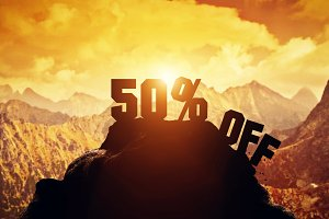 50% off writing on a mountain peak.