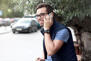 Happy young man talking on the phone