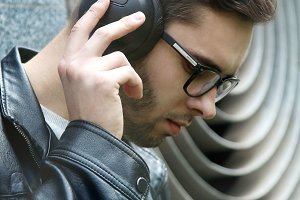 Handsome serious young man listening