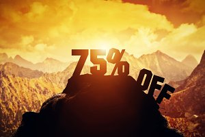 75% off writing on a mountain peak.
