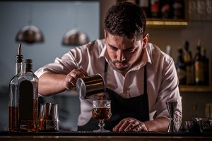 Barman pouring coffee