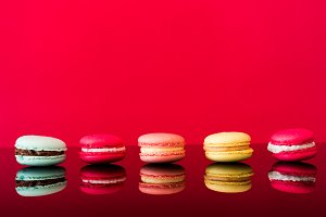 Colorful Yummy Macarons on Glossy Ta