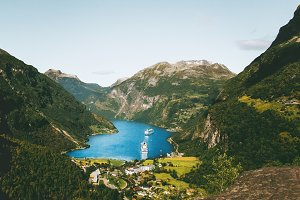 Geiranger fjord and ships mountains