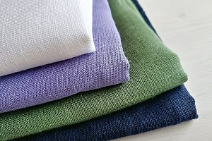 Pile of linen fabrics.