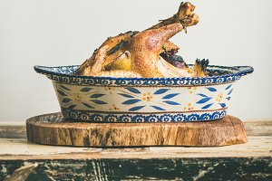 Roasted whole chicken for Christmas eve celebration table, square crop