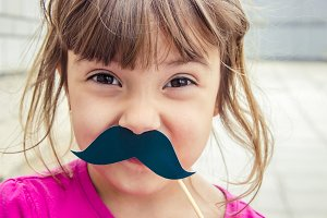 A child with a mustache and lips.