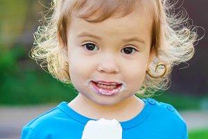 The child eats ice cream.