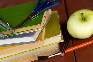 Pile of books,apple,school equipment