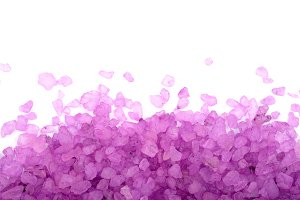 Violet sea salt isolated on white background, lavender with copy space for your text. Top view. Flat lay