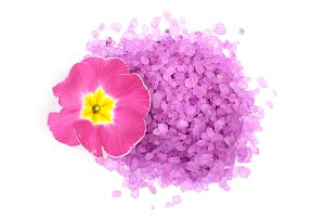 Violet sea salt with flover isolated on white background. Top view. Flat lay
