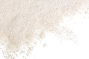 Pile of flour isolated on white background with copy space for your text. Top view. Flat lay