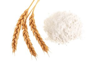 ears of wheat and pile of flour isolated on white background. Top view. Flat lay