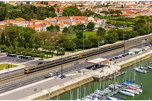 Suburban train passing by a street of Lisbon - Portugal
