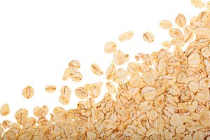 oat flakes isolated on white background with copy space for your text. Top view