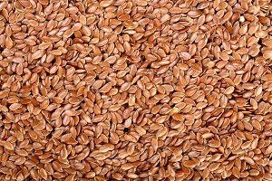 flax seeds as a background. Top view