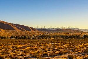 Windmills along a highway in Mojave desert, California
