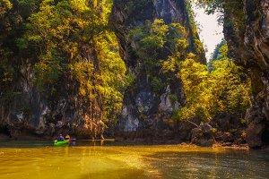 Kayaking under high cliffs in Thailand